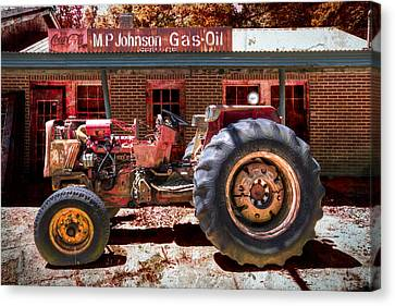 Antique Tractor Canvas Print by Debra and Dave Vanderlaan