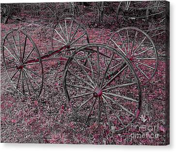 Canvas Print featuring the photograph Antique Wagon Wheels by Sherman Perry