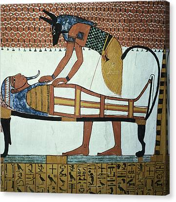 Anubis And A Mummy, From The Tomb Of Sennedjem, The Workers Village, New Kingdom Mural See Canvas Print by Egyptian 19th Dynasty