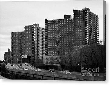 apartment blocks in Harlem and FDR Drive from the east river new york city Canvas Print
