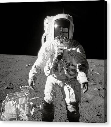 Apollo 12 Moonwalk - 1969 Canvas Print by World Art Prints And Designs