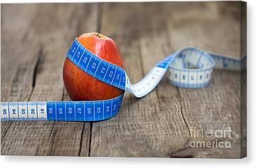 Apple And Measuring Tape Canvas Print by Aged Pixel