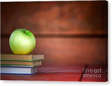 Apple On Pile Of Books Canvas Print by Michal Bednarek