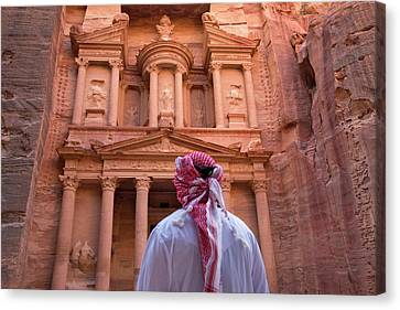 Arab Man Watching Facade Of Treasury Canvas Print by Keren Su