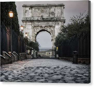 Arch Of Titus Morning Glow Canvas Print by Joan Carroll