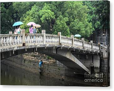 Arched Chinese Bridge With Umbrellas - Shamian Island - Guangzhou - Canton - China Canvas Print by David Hill