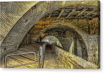 Arched Walkway Canvas Print by Jim Lepard