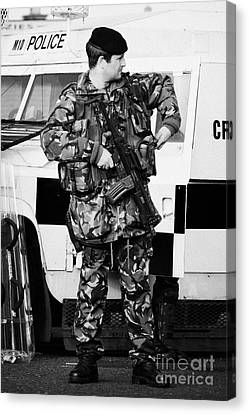 Terrorist Canvas Print - Armed British Soldier At Psni Landrover On Crumlin Road At Ardoyne Shops Belfast 12th July by Joe Fox