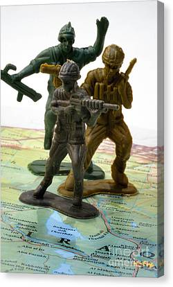 Armed Toy Soliders On Iraq Map Canvas Print by Amy Cicconi