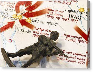 Army Man Lying On Middle East Conflicts Map Canvas Print by Amy Cicconi