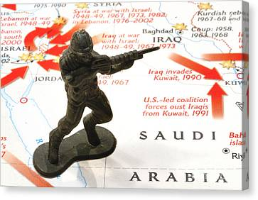 Army Man Standing On Middle East Conflicts Map Canvas Print by Amy Cicconi