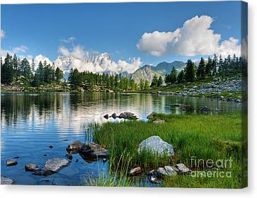 Canvas Print featuring the photograph Arpy Lake - Aosta Valley by Antonio Scarpi