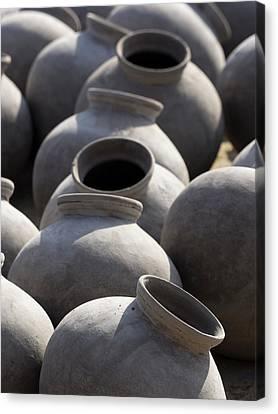 Artisan Making Clay Pot Canvas Print by David H. Wells