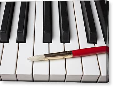 Artist Brush On Piano Keys Canvas Print by Garry Gay