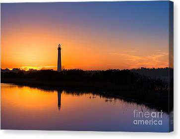 As The Sun Sets And The Water Reflects Canvas Print