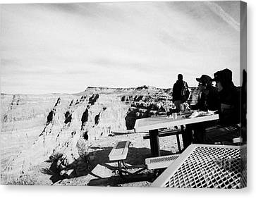 Asian Tourists Enjoying Indian Buffet Food At Guano Point On The Edge Of The Grand Canyon Home Of Th Canvas Print by Joe Fox