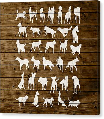 Assorted Dog Species Outline White Distressed Paint On Reclaimed Wood Planks Canvas Print