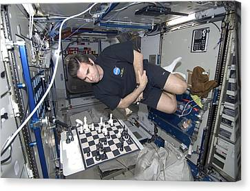 Astronaut Chess Game On The Iss Canvas Print