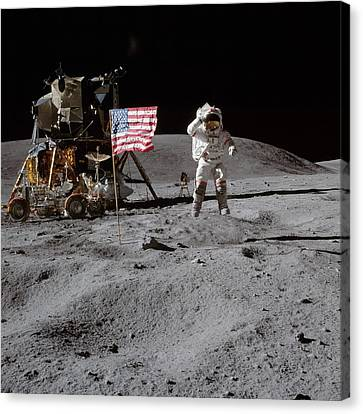 Astronaut Saluting The American Flag During Apollo 16 Mission Canvas Print by Celestial Images