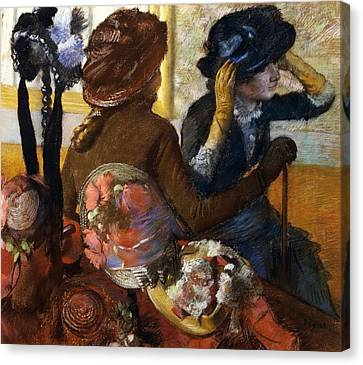 At Milliner's Canvas Print by Edgar Degas