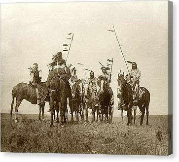 First Nations Canvas Print - Atsina Warriors On Horseback by Underwood Archives