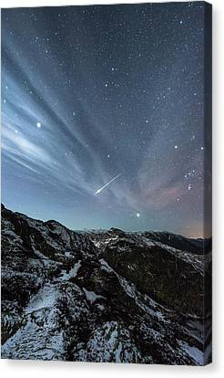 Aurora Borealis And Shooting Star Canvas Print by Tommy Eliassen