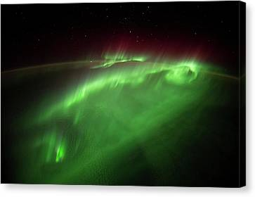 Aurora Borealis Seen From The Iss Canvas Print by Nasa