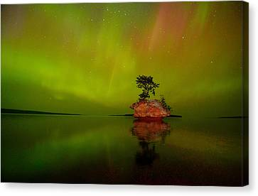 Aurora Over Honeymoon Rock In Lake Superior Canvas Print by Jeff Rennicke