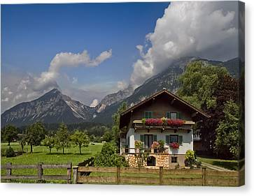 Austrian Cottage Canvas Print by Debra and Dave Vanderlaan