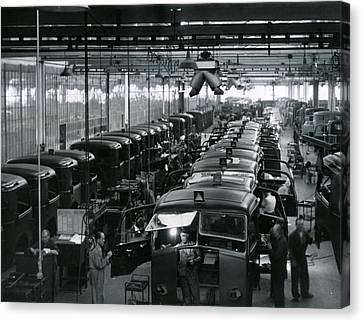Automobile Factory Workers Canvas Print by Retro Images Archive