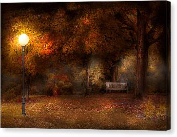Autumn - A Park Bench Canvas Print by Mike Savad