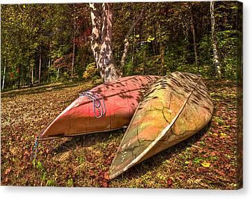 Autumn Canoes Canvas Print by Debra and Dave Vanderlaan