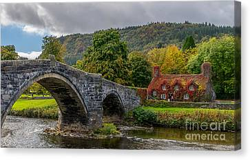 Autumn Cottage Canvas Print by Adrian Evans