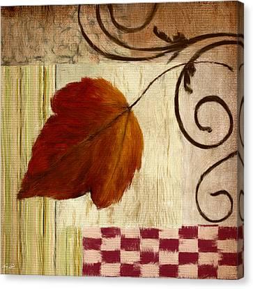 Autumn Leaf Canvas Print by Lourry Legarde