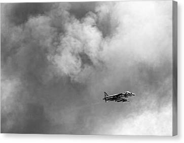Av-8b Harrier Flies Through The Smoke Of War Canvas Print by Peter Tellone