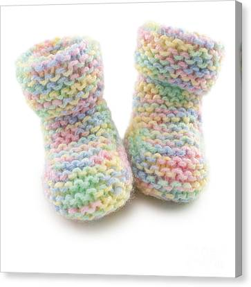 Baby Booties In Multi Coloured Yard Canvas Print by Colin and Linda McKie