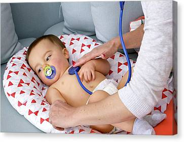Baby Boy Being Examined By A Doctor Canvas Print