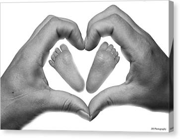 Baby Feet In Mothers Hand Canvas Print by Jay Harrison