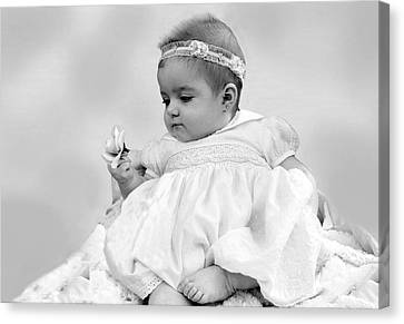Baby Girl Holding Flower Black And White Canvas Print