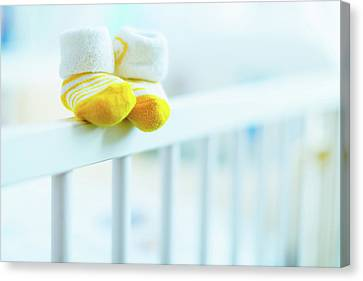 Baby Shoes On The Edge Of A Cot Canvas Print by Wladimir Bulgar