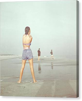 Back View Of Three People At A Beach Canvas Print by Serge Balkin