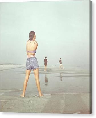 Bikini Canvas Print - Back View Of Three People At A Beach by Serge Balkin