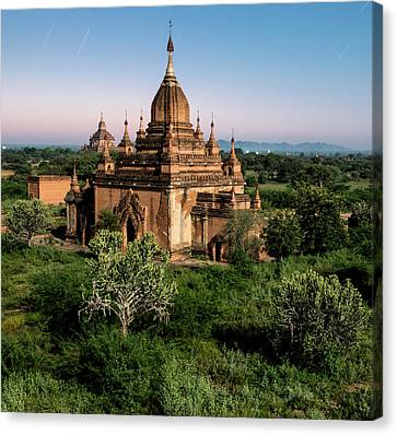 Bagan, Ancient Temple Lit By Moonlight Canvas Print by Martin Puddy