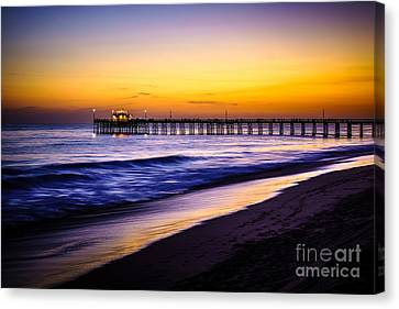 Balboa Pier At Sunset In Newport Beach California Canvas Print by Paul Velgos