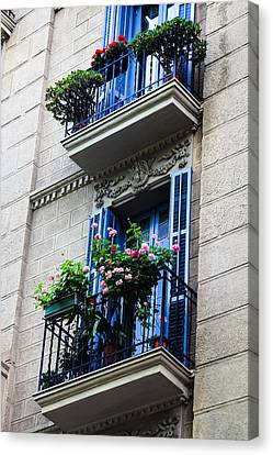 Balconies In Bloom Canvas Print by Menachem Ganon