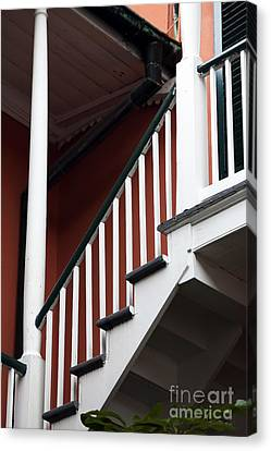 Balcony Stairs Canvas Print by John Rizzuto