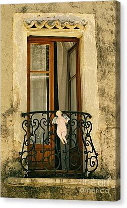Balcony With Angel, France Canvas Print by Holly C. Freeman