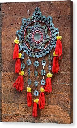 Bali, Indonesia Metalwork And Cloth Canvas Print by Charles O. Cecil