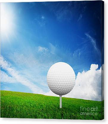 Golf Ball Canvas Print - Ball On Tee On Green Golf Field by Michal Bednarek