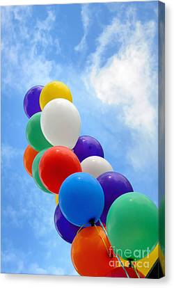 Balloons Against A Cloudy Sky Canvas Print by Amy Cicconi
